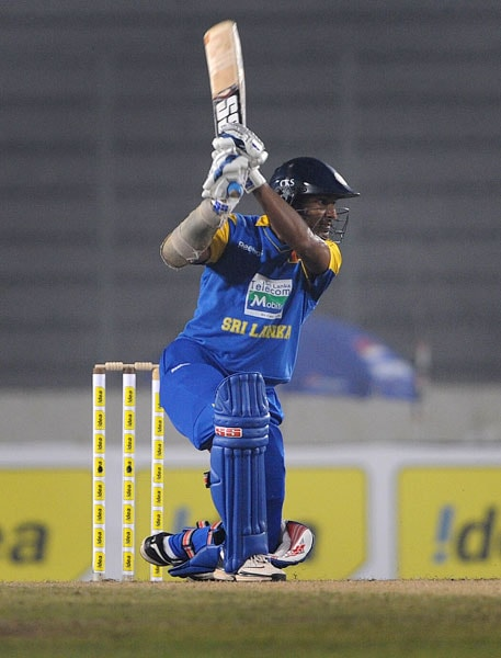 Sri Lanka's Kumar Sangakkara plays a shot against Bangladesh during their first One-Day International of the tri-series in Dhaka. (AFP Photo)