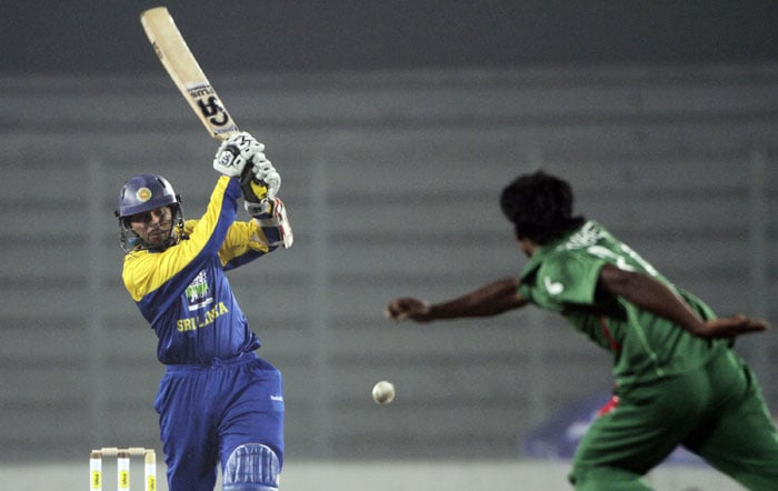 Sri Lanka's Tilakaratne Dilshan plays a shot during their first One-Day International of the tri-series in Dhaka. (AP Photo)