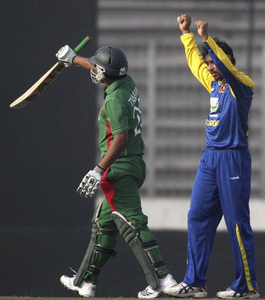 Sri Lanka's Tillakaratne Dilshan celebrates dismissing Bangladesh's Tamim Iqbal during their first One-Day International of the tri-series in Dhaka. (AP Photo)