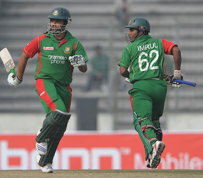 Bangladeshi cricketers Tamim Iqbal and Imrul Kayes take a run against Sri Lanka during their first One-Day International of the tri-series in Dhaka. (AFP Photo)