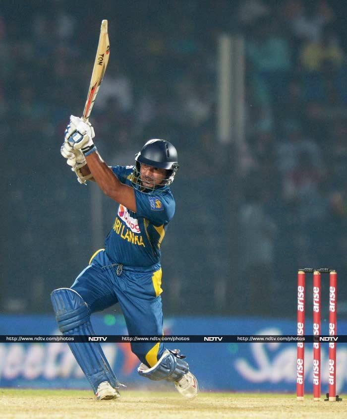 Sri Lanka defeated India by a narrow margin of 2 wickets to take the top spot in the points table. In what was a close match, Kumar Sanggakara's 103 proved to be the difference between the two competing teams. <br><br>Here are some of the highlights. (Images courtesy: AFP and AP)