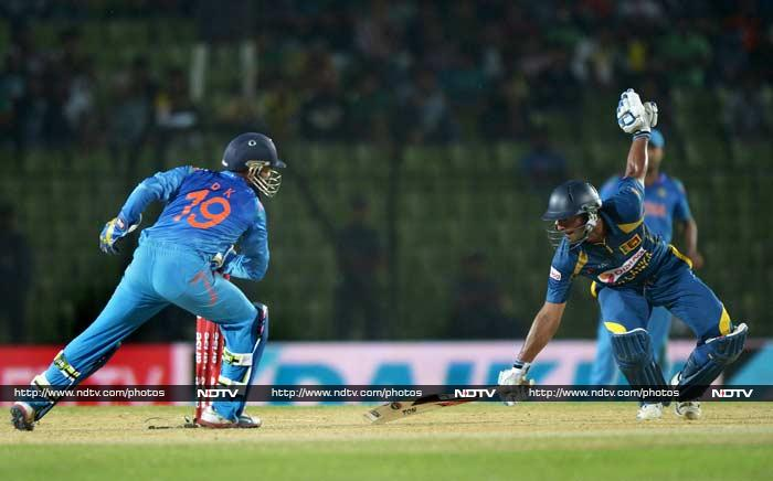 Sangakkara at the other end survived a close call when - on 30 - he was let off by Dinesh Karthik who failed to knock the bails off.