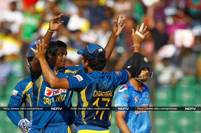 India skipper Virat Kohli (48) is seen here making his way back. He was removed by Ajantha Mendis who was responsible for staging a collapse with his four-wicket haul.