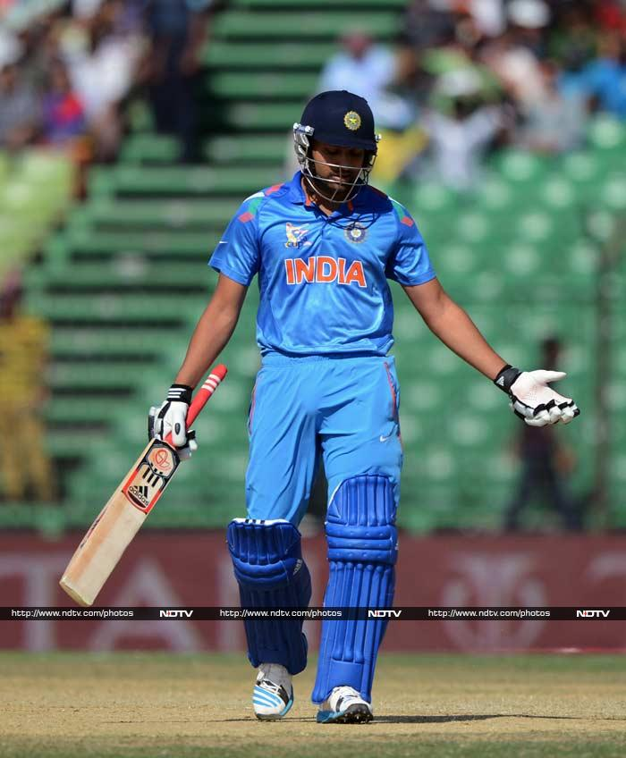 Indian batting was rather jaded apart from Dhawan's knock. <br><br>Rohit Sharma is seen here making his way back after scoring just 13.