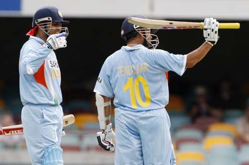 Sachin Tendulkar, right, gestures the stands as his team-mate Virender Sehwag, left, comes in after reaching 16,000 runs during their On-Day cricket international against Sri Lanka in Brisbane on Tuesday, February 5, 2008.