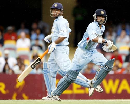 Gautam Gambhir and his captain MS Dhoni, left, cross as they run during their One-Day cricket international against Sri Lanka in Brisbane on Tuesday, February 5, 2008.