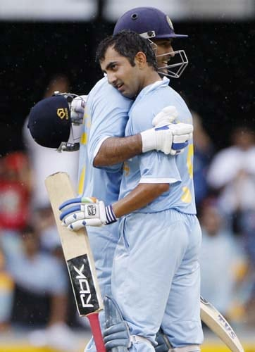 Gautam Gambhir, right, is embraced by his captain MS Dhoni after scoring a century against Sri Lanka in a One-Day cricket international in Brisbane on Tuesday, February 5, 2008.
