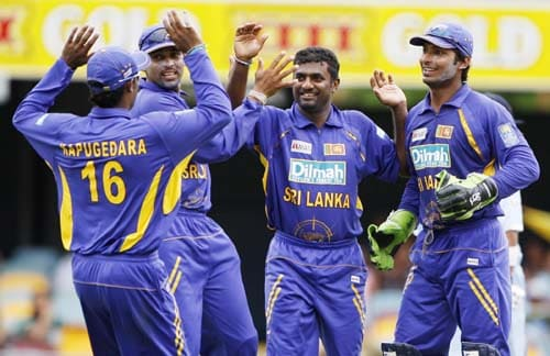 Muttiah Muralitharan second right, is congratulated by team-mates after dismissing Indian batsman Yuvraj Singh during their One-Day cricket international in Brisbane on Tuesday, February 5, 2008.