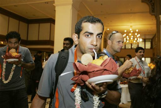 Gautam Gambhir drinks coconut water upon his arrival at a hotel in Colombo on Monday. (AP Photo)