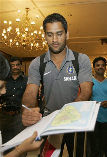Mahendra Singh Dhoni signs autograph as he arrives at a hotel in Colombo on Monday. (AP Photo)