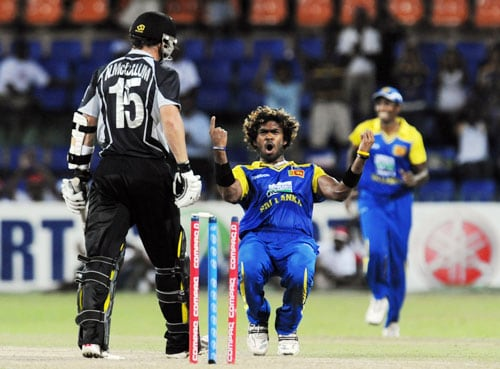 Sri Lanka's Lasith Malinga celebrates the dismissal of New Zealand's Nathan McCullum during the first ODI of the Tri-Nation Championship trophy in Colombo. (AFP Photo)