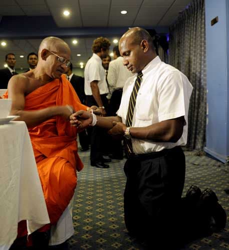 Sri Lanka's star batsman Sanath Jayasuriya is blessed by a Buddhist monk in Colombo on May 28, 2009 before leaving for England to play in the ICC Twenty20 World Cup. (AFP Photo)