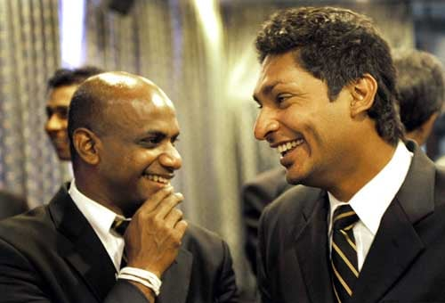 Sanath Jayasuriya shares a light moment with captain Kumar Sangakkara, during a religious ceremony in Colombo before leaving for England to play in the ICC Twenty20 World Cup. (AFP Photo)
