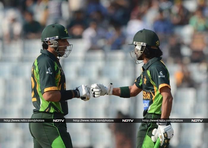 It was then that skipper Misbah-ul-Haq (left) and Fawad Alam took control and repaired the initial damage.