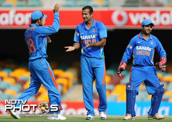 India's Irfan Pathan (C) celebrates with teammates after bowling out Sri Lanka's Dinesh Chandimal during the one-day international cricket match in Brisbane.