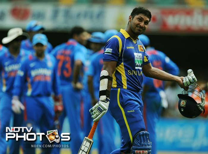 Sri Lanka's Kumar Sangakkara leaves the field after being dismissed during the one day international cricket match against India in Brisbane.