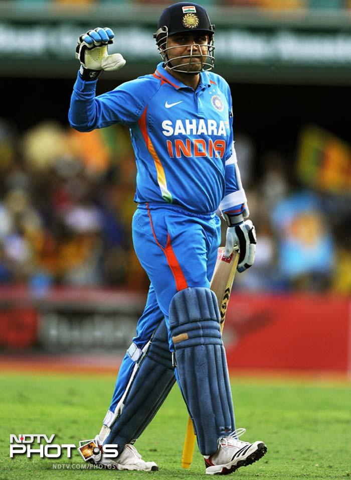 India's Virender Sehwag leaves the field after being dismissed for no runs during the one-day international cricket match against Sri Lanka in Brisbane.