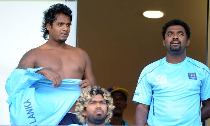 He hasn't played a match in this World Cup, but Dilhara Fernando has been clicked more with his shirt off than wearing it. Although he is not likely to feature in the team on Saturday as well, solidarity with fellow players in bearing the Mumbai sun is clear from this snap. (AFP PHOTO)