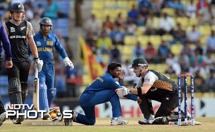 McCullum tends to Dhananjaya after his shot went between the bowler's hands and struck him on his face.<br><br>New Zealand eventually managed to set a target of 175.