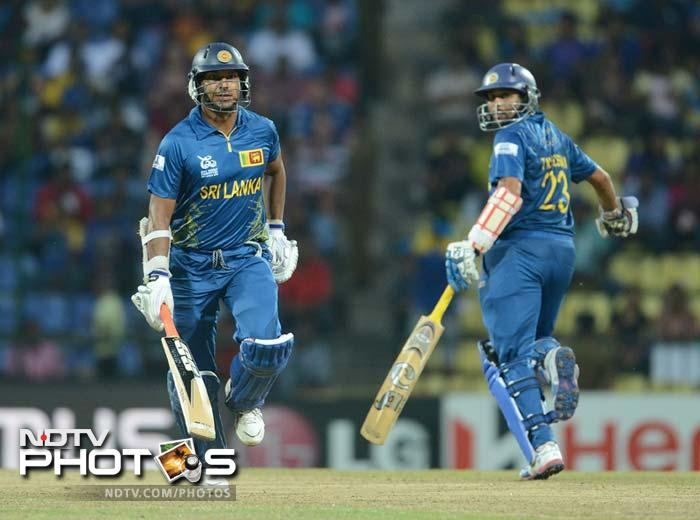 In reply, Sri Lanka's top-order was on fire. Mahela Jayawardena (not in pic) smashed 44 off 26. He was overtaken by Tillakaratne Dilshan who hit 76 off 53, supported by Kumar Sangakkara (left).