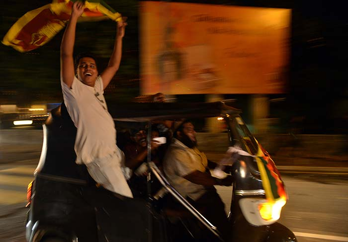 The jubilant fans in Colombo drove around in auto rickshaws in the wee hours after the game, letting the Sri Lankan flag fly high