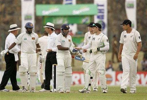 New Zealand wicketkeeper Brendon McCullum congratulates Sri Lanka's Mahela Jayawardene who scored a century, as teammate Thilan Samaraweera looks on at the end of Day 1 of the first Test between Sri Lanka and New Zealand in Galle. (AP Photo)