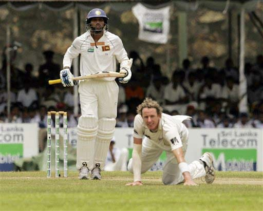 Tillakaratne Dilshan looks on after playing a shot, as New Zealand's bowler Iain O'Brian is seen on the ground during Day 1 of the first Test between Sri Lanka and New Zealand in Galle. (AP Photo)