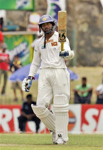 Tillakaratne Dilshan raises his bat after completing fifty during Day 1 of the first Test between Sri Lanka and New Zealand in Galle. (AP Photo)