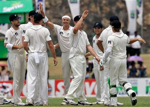 Chris Martin celebrates the wicket of Tharanga Paranavitana with his teammates during Day 1 of the first Test between Sri Lanka and New Zealand in Galle. (AP Photo)