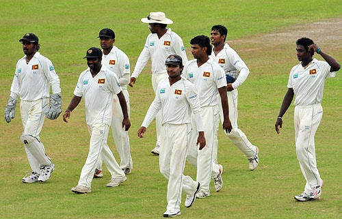 Sri Lankan cricketers are led by captain Kumar Sangakkara as they leave the pitch at the end of the third day of the first Test match between Sri Lanka and New Zealand at The Galle International Cricket Stadium on August 20, 2009. At stumps New Zealand had advanced to 281 runs for the loss of eight wickets in their first innings. (AFP Photo)