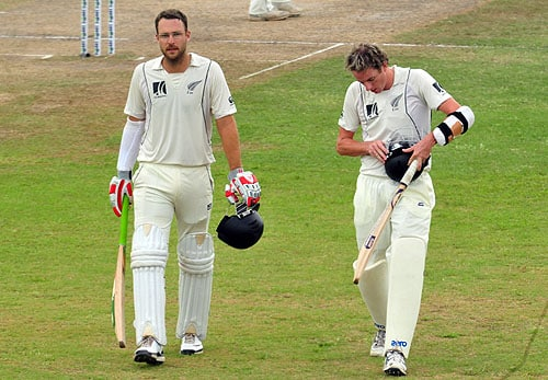 New Zealand captain Daniel Vettori and teammate Iain O' Brien leave the ground at the end of the third day of the first Test match between Sri Lanka and New Zealand at The Galle International Cricket Stadium in Galle on Thursday. (AFP Photo)