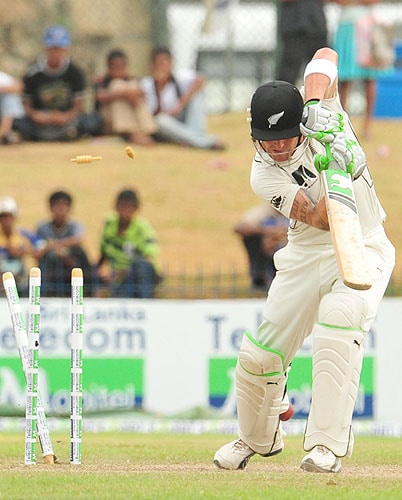 New Zealand batsman Brendon McCullum is dismissed by Sri Lankan pacer Thilan Thushara during the third day of the first Test match at The Galle International Cricket Stadium in Galle on Thursday. (AFP Photo)