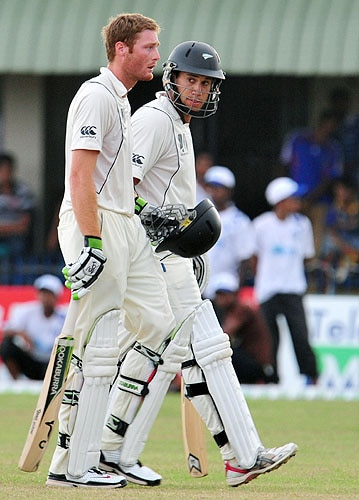 New Zealand's Martin Guptill and Ross Taylor leave the ground at the end of the fourth day of the first Test match against Sri Lanka at The Galle International Cricket Stadium in Galle on Friday. At stumps New Zealand were 30 runs for the loss of one wicket in their second innings as they chase a total of 413 for victory. (AFP Photo)
