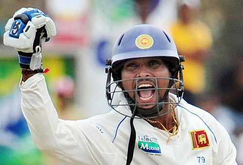 Sri Lankan's Tillekeratne Dilshan reacts after scoring a century during the fourth day of the first Test match against New Zealand at The Galle International Cricket Stadium in Galle on Friday. (AFP Photo)
