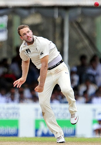 New Zealand captain Daniel Vettori delivers a ball during the fourth day of the first Test match against Sri Lanka at The Galle International Cricket Stadium in Galle on Friday. (AFP Photo)
