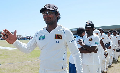 1. Sri Lankan cricketers are led by captain Kumar Sangakkara as they celebrate victory at the conclusion of the final day of the first Test match between Sri Lanka and New Zealand at The Galle International Cricket Stadium in Galle on August 22, 2009. (AFP Photo)