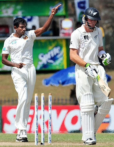 Sri Lanka's Thilan Thushara gestures as he celebrates the dismissal of New Zealand's Martin Guptill during the final day of the first Test match at The Galle International Cricket Stadium in Galle on Saturday. (AFP Photo)