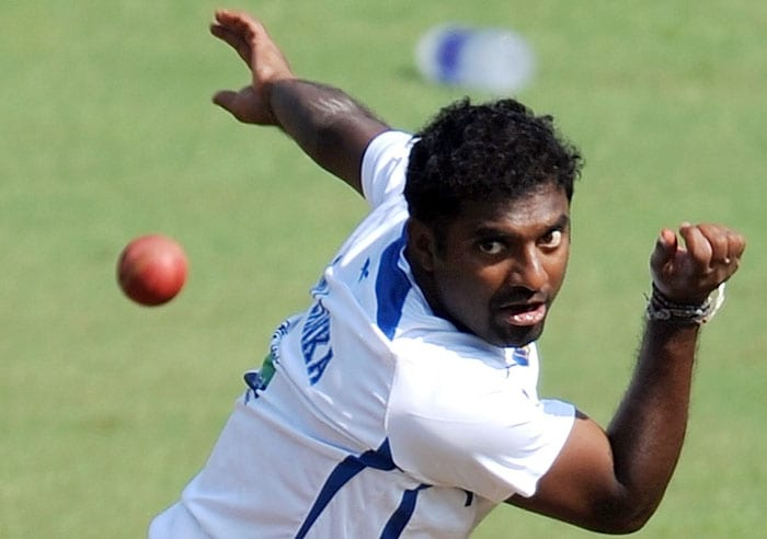 Sri Lankan cricketer Muttiah Muralitharan bowls during a training session ahead of the third and final Test match against India in Mumbai on November 30, 2009. India lead the 3-match series 1-0. (AFP Photo)