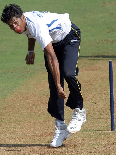 Chanaka Welegedara bowls during a training session ahead of the third and final Test against India in Mumbai. (AFP Photo)