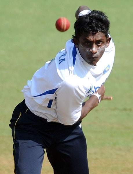 Ajantha Mendis bowls during a training session ahead of the third and final Test against India in Mumbai. (AFP Photo)