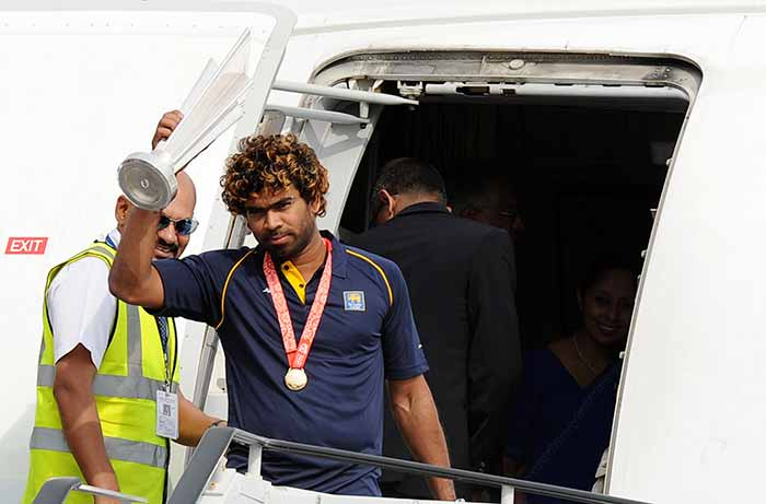 The victorious Sri Lankan team, led by Lasith Malinga, arrived in Sri Lanka to rousing reception from excited fans (All images AFP).