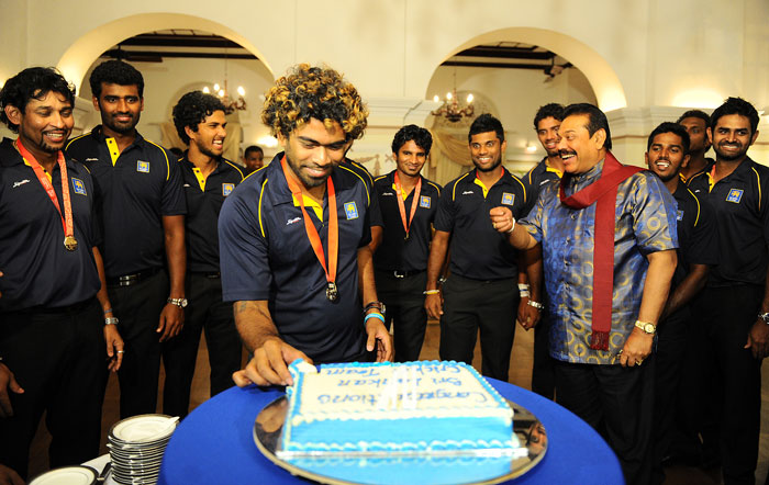 Lasith Malinga was all smiles as he cut a big cake during their World Cup triumph celebrations.
