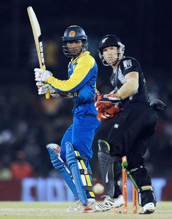 Sri Lankan cricketer Upul Tharanga plays a stroke as New Zealand wicketkeeper Gareth Hopkins looks on during the second ODI of the Micromax tri-series between Sri Lanka and New Zealand at the Rangiri Dambulla International Cricket stadium in Dambulla. (AFP Photo)