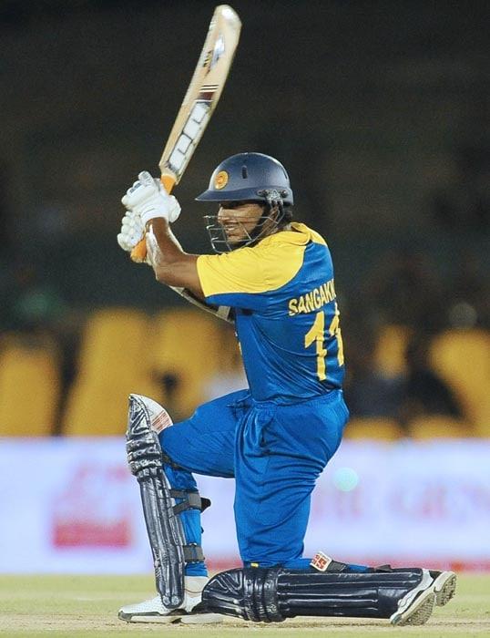 Sri Lankan cricket captain Kumar Sangakkara plays a stroke the second ODI of the Micromax tri-series between Sri Lanka and New Zealand at the Rangiri Dambulla International Cricket stadium in Dambulla. (AFP Photo)