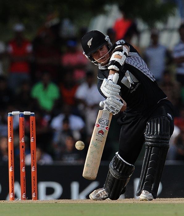 New Zealand cricketer Nathan McCullum plays a shot during the second ODI of the Micromax tri-series between Sri Lanka and New Zealand at the Rangiri Dambulla International Cricket stadium in Dambulla. (AFP Photo)