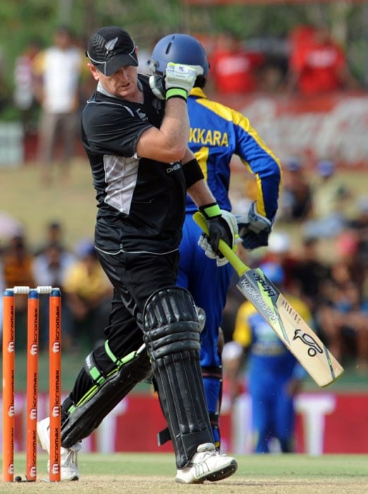 New Zealand cricketer Scott Styris reacts as he walks back to the pavilion after his dismissal during the second ODI of the Micromax tri-series between Sri Lanka and New Zealand at the Rangiri Dambulla International Cricket stadium in Dambulla. (AFP Photo)