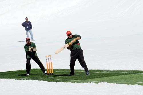 Former England cricketer Neal Radford plays a shot during a cricket match on snow in Bernese Alps in Switzerland. (AFP Photo)
