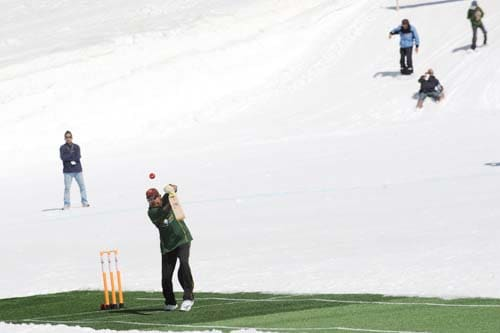 Former Indian cricketer Syed Kirmani plays a shot during a cricket match on snow in Bernese Alps in Switzerland. (AFP Photo)