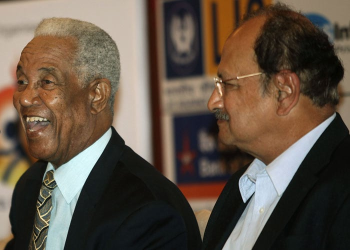 Former West Indies cricket captain and all rounder Gary Sobers, left, laughs as former Indian cricketer Ajit Wadekar looks on during an event in Mumbai. (AP Photo)