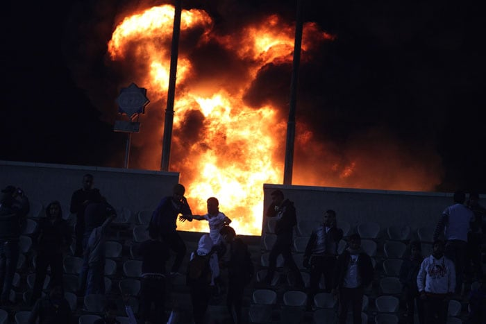 At least 74 people were killed and hundreds injured after soccer fans rushed the field in the seaside city of Port Said on Wednesday following an upset victory by the home team over Egypt's top club, setting off clashes and a stampede as riot police largely failed to intervene.<br><br>It was a bloody reminder of the deteriorating security in the Arab world's most populous country as instability continues nearly a year after former President Hosni Mubarak was swept out of power in a popular uprising. (AP Photo)